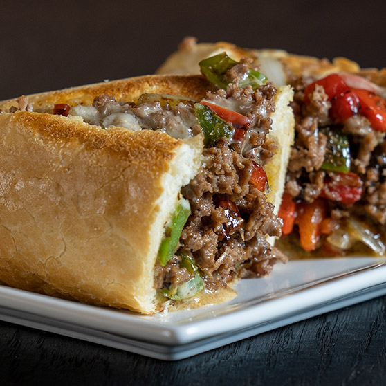 Photo sample of close up of steak and pepper sandwich