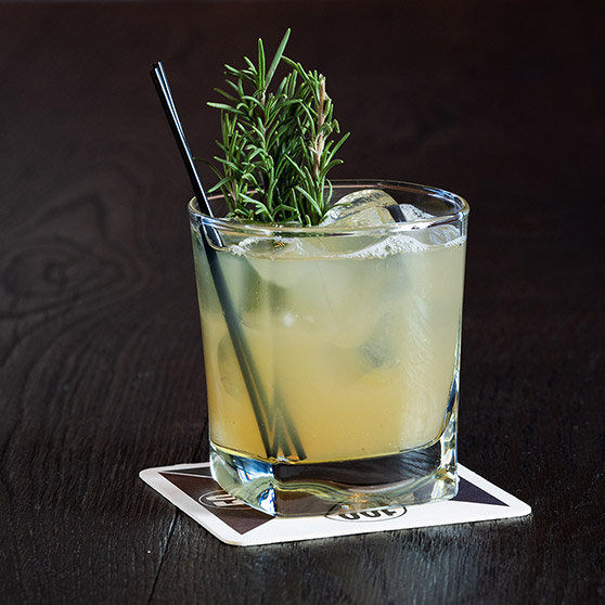 Photo sample of close up of cocktail with large rosemary sprig